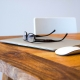 macbook air on table with magic mouse and glasses
