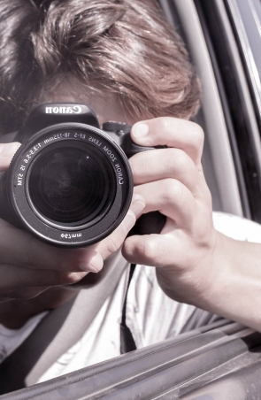 man takes photo of self in wingmirror