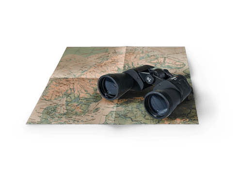 Binoculars rested on Map